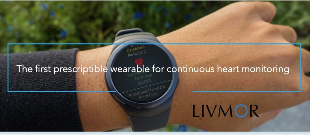 """wrist wearing the Livmor wearable with text: """"The first prescriptible wearable for continuous heart monitoring"""""""